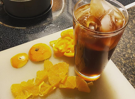 Iced Orange Lighting Recipe: Cold Brew, Orange Simple Syrup, & a Splash of Chai Tea