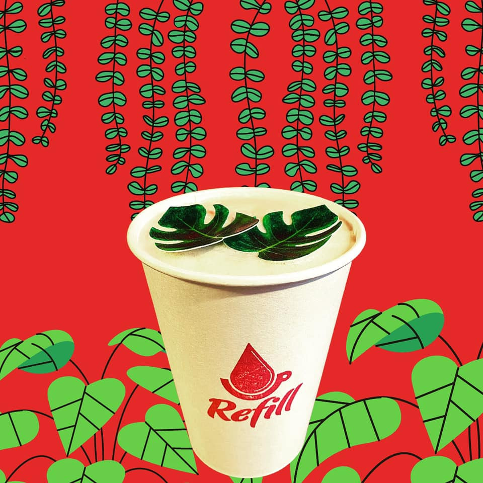 The Oglewood Avenue Latte, created by Refill Coffee Cart with flavors of vanilla, chai & edible leafs.