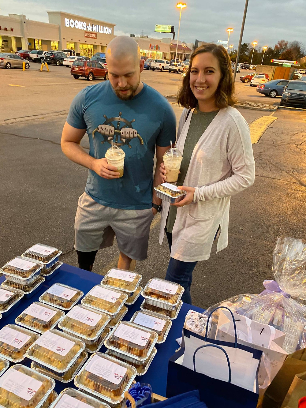 2 of Lora-Joy & Andy's clients, with their frappe, picking out to-go puddings from Little Bread Puddings