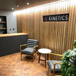 Kinetics desk and feature wall