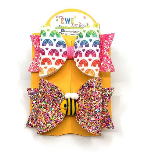 2 Pk of Rainbow Print and Bee Clay Medium Hair Bow Clips