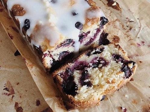 LEMON & BLUEBERRY DRIZZLE CAKE SLICE