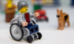 lego figurine in a wheelchair.