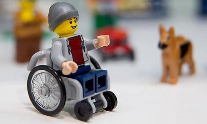 lego figurine in a wheelchair.