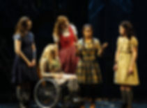 """Ali Stroker, second from left, in """"Spring Awakening."""" Credit Sara Krulwich/The New York Times - 5 girls on stage, one of them in a wheelchair."""