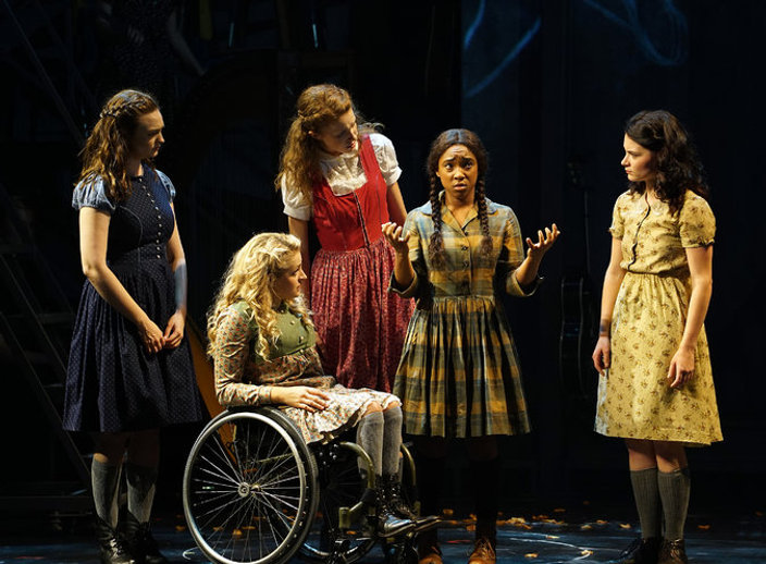 "Ali Stroker, second from left, in ""Spring Awakening."" Credit Sara Krulwich/The New York Times - 5 girls on stage, one of them in a wheelchair."