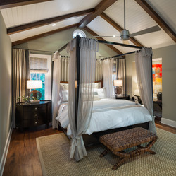 Vaulted ceiling bedroom designed with modern coastal accents