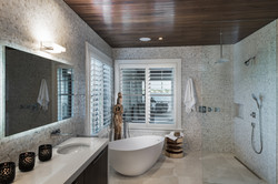 Open concept bathroom with separate tub and shower in modern design