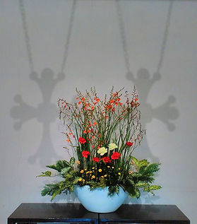 Cross and Flower display behind Altar