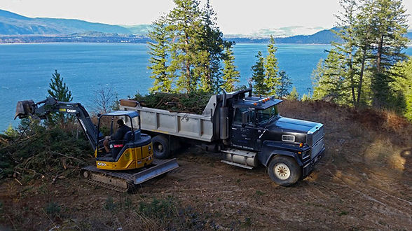 Sandpoint, Sagle, Hope, Ponderay, Lake Pend Oreille, Bonner County, Excavation, property development, land development, septic systems, utilities, sewer, electrical lines, water lines, dump trucking, gravel delivery, landscaping, landscape, hardscape, road building, driveways, road grading, driveway grading, grading, rock walls, retaining walls, irrigation, sprinklers, logging, patios, site prep, land clearing, brush clearing, pastures, foundations, top soil, mulch, gravel, heavy equipment,  tractor work, bull dozer, excavator, skid steer, ponds, snow plowing, snow removal, tree removal, hazard tree removal, firewood, fences, boulders, boulder placing, rock placing, dock building, ponds, drainage, drainage systems, French drains, curtain drains, trail building, culverts