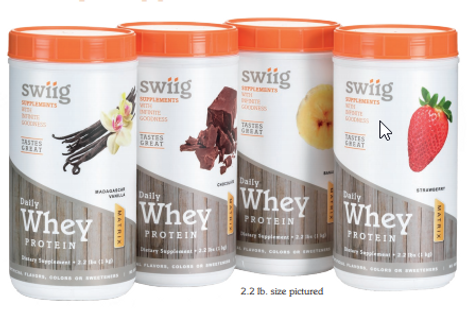 Picture of whey protein, shaker bottles and weights.