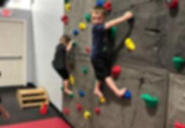 picture of children climbing an indoor rockwall