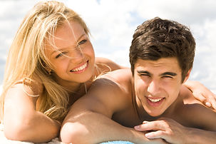picture of guy and girl tanning