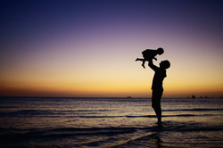 beach-silhouette-adult-baby-in-arms
