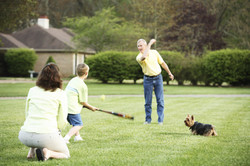 family-playing-on-lawn