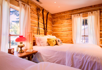 Chula Vista Cabin downstairs bedroom with 2 queen beds