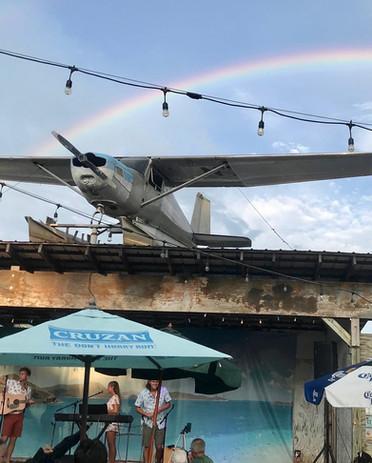 A rainbow provides a nice halo over GNT at Spike's Beach.