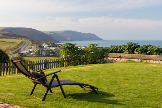 Relax in one of the steamer chairs in the garden and gaze out across the ocean