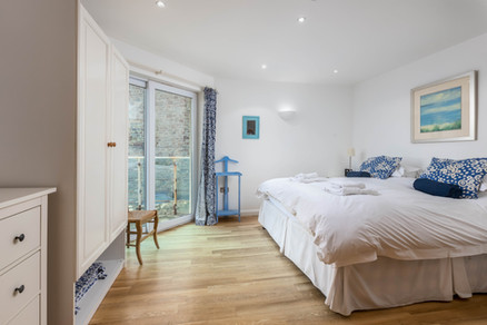 French doors let light and air flood in to this bedroom