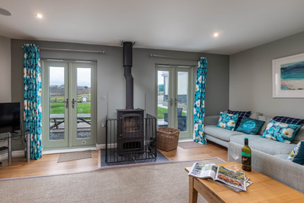 Snuggle up in front of the woodburner with a glass of red