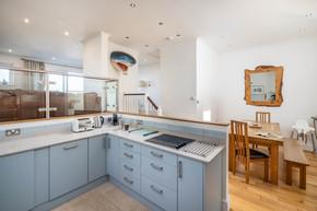 The powder blue kitchen is open plan