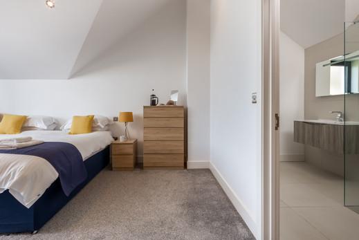 Bedroom with mirrored wardrobe doors