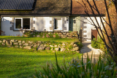 The inviting exterior of Cottage 2 with low Cornish hedging.