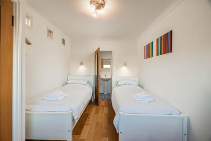 A modern twin room with colourful artwork