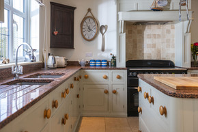 A large kitchen with a real 'farmhouse' feel