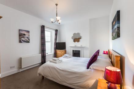 Double bedroom adorned with original artwork