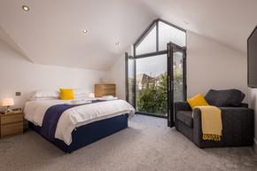 View through patio doors in the master bedroom