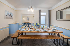 Gather for dinner on one of the benches around the modern dining table