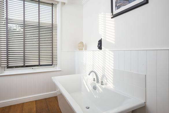 The sunlight streaming through a bathroom window