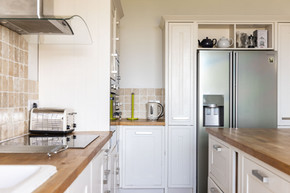 Modern kitchen complete with American-style fridge