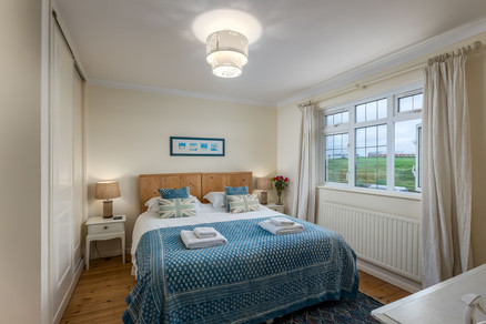 A cosy double bedroom with views of the countryside