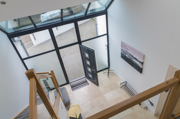 Looking down from the landing to the front door