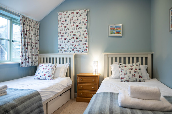 Nautical accents add a spot of fun to this twin bedroom