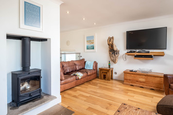 Warm your toes in front of the cosy woodburner