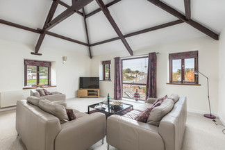The living area has an impressive vaulted ceiling