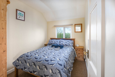 A double bedroom with cosy hot water bottles.