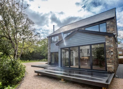 Bi-fold doors opening out onto the level deck
