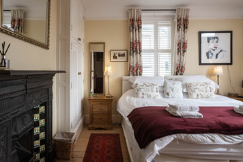 Traditional features abound in the master bedroom