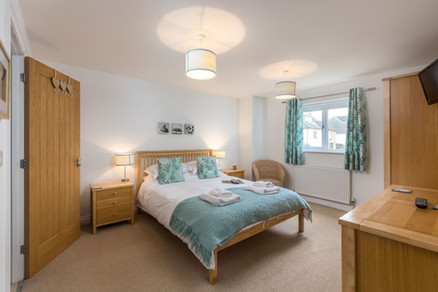 Rest your head in this double bedroom after a day exploring the Cornish coast