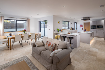 The light-flooded open-plan living dining area