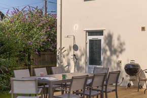 The outdoor space is perfect for al fresco dining or a barbecue