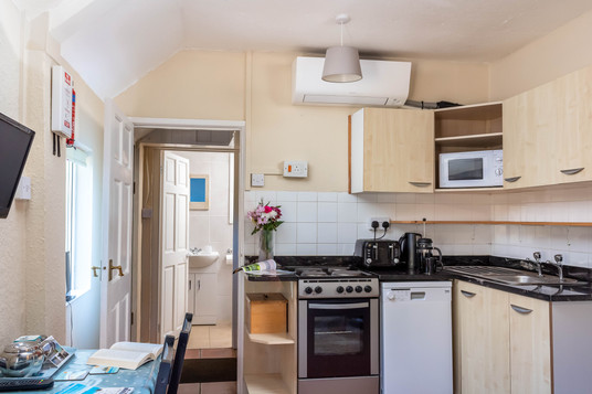 Cottage 1's kitchen, with oven and microwave, has everything you need to self-cater.