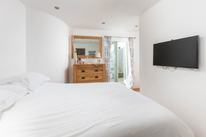 White linen and modern fittings make for a cool contemporary bedroom