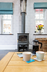 On cooler mornings, take your coffee by the fire