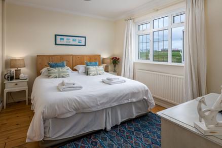 Cosy bedrooms with oak flooring