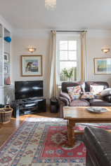 A sash window lets light flood in to the sitting room